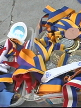 Medals belonging to Carol Pickett - Champion of World Eskimo Indian Olympics, Native Youth Olympics, and Arctic Winter Games.